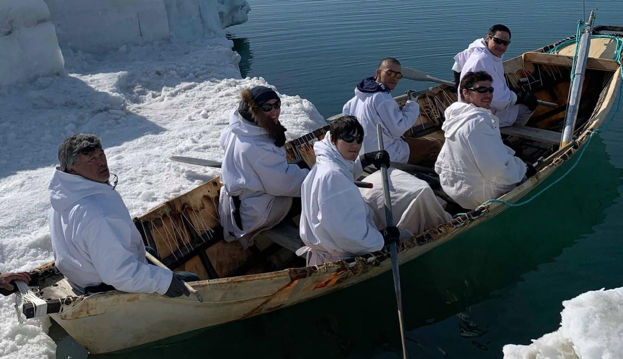 Gordon Ikayuak Brower and his whaling crew about to get out in open water on their traditional umiaq/seal skin boat. Photo: Courtesy of Gordon Ikayuak Brower