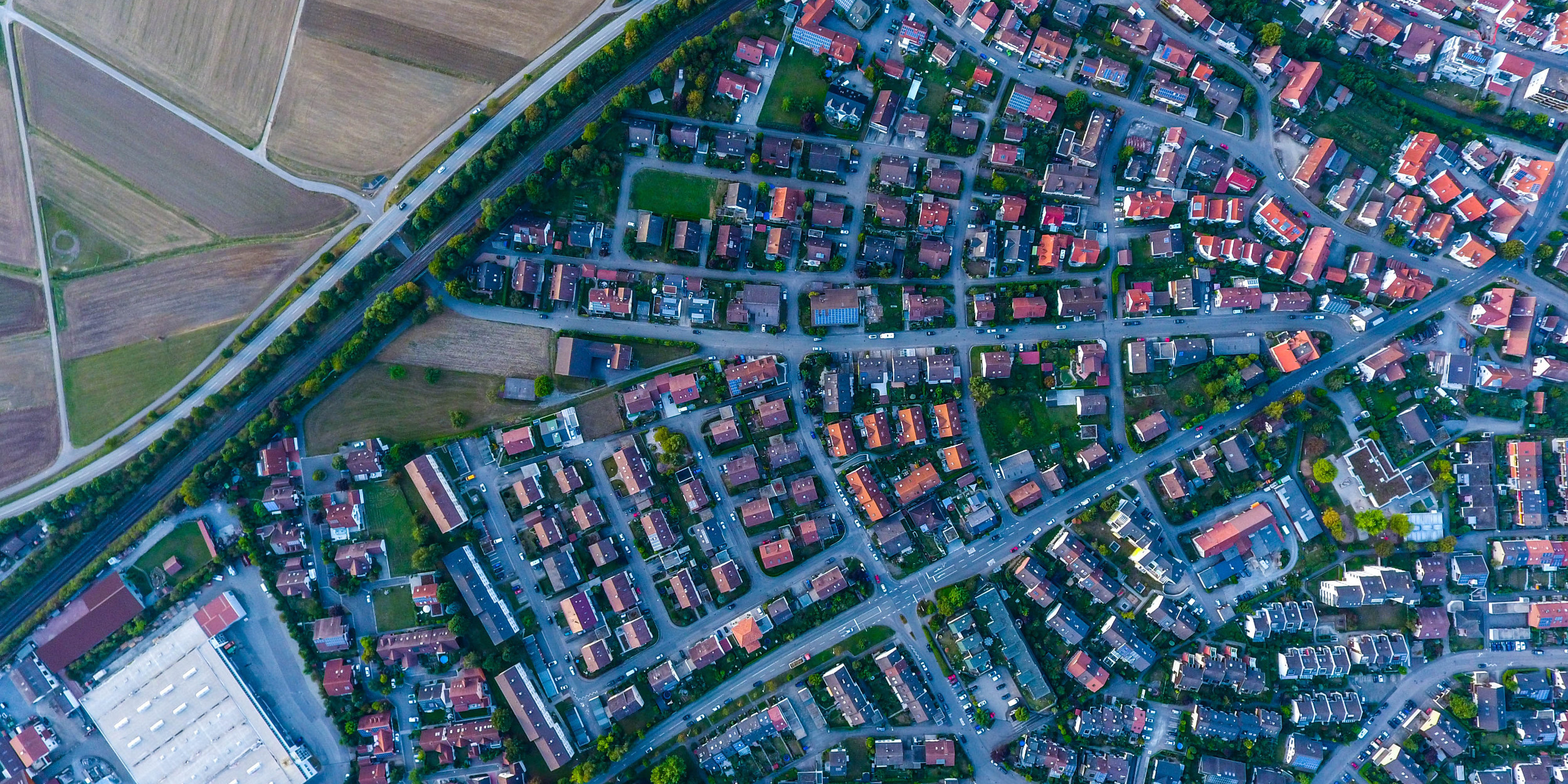 Image: Contrast between highly dense and rural areas in Ehningen, Germany. Max Böttinger, Unsplash.