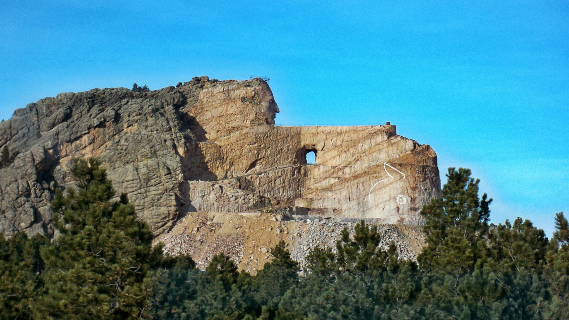 The Crazy Horse Memorial is one of the world's largest sculptural undertakings. A mountain monument memorial of Lakota leader Crazy Horse is under construction on privately held land in the Black Hills in South Dakota, United States.